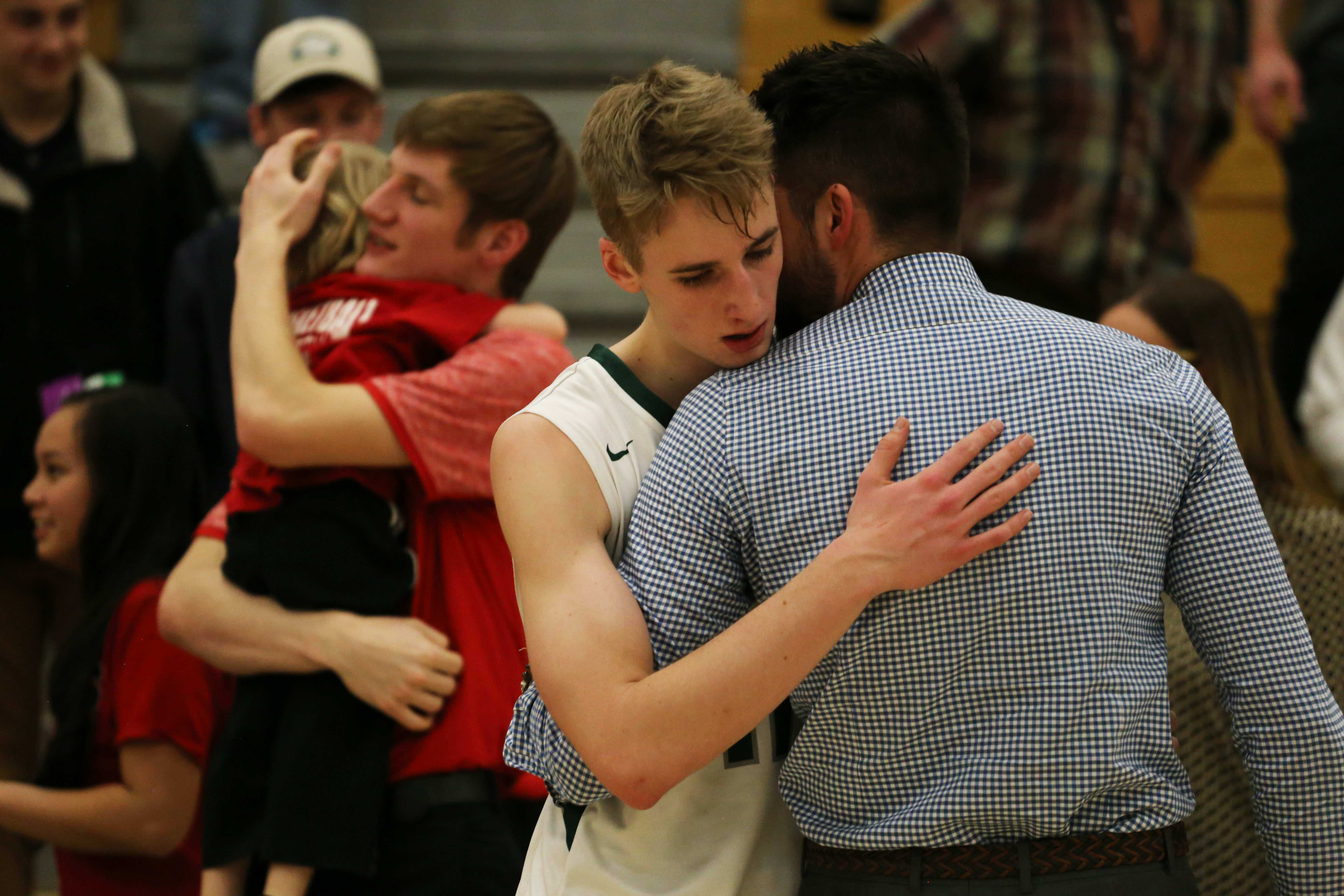 Senior Kellen Ireland hears words of encouragement and consolation from Coach Eric Valerio following the first round playoff loss to Glenwood Springs on Wednesday, February 22.