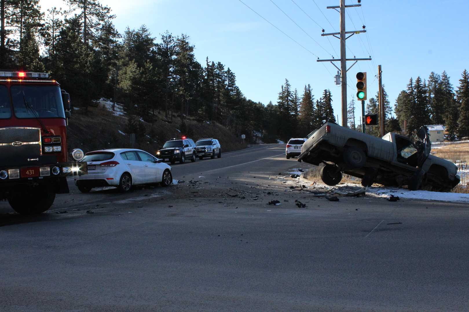 Debris decorates the intersection at Highway 73 and the Conifer High School driveway on the morning of Thursday, March 2, after an accident involving a student and an unidentified male driving a truck on Hwy 73.