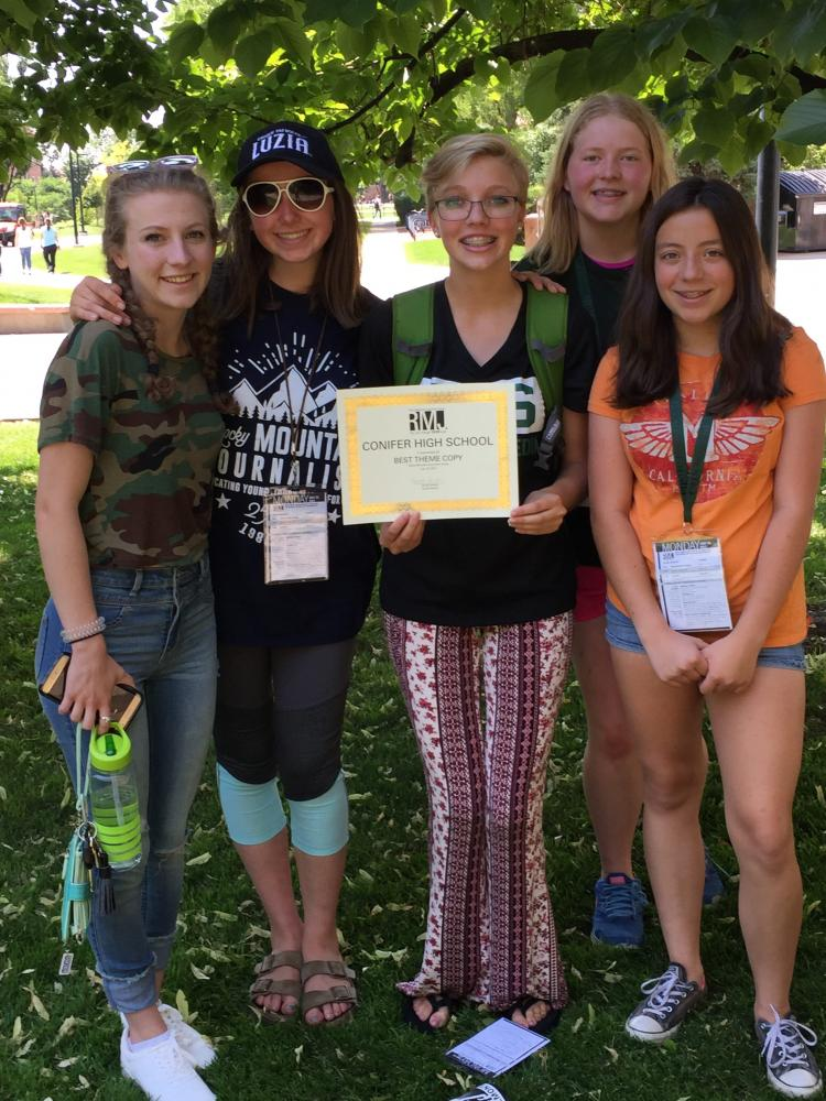 Mackenzie Orr, '18, Editor Lucia Lewis, '18, Editor Bailey Sessions, '18, Trinity Foreman, '20, and Samantha Smith, '21, pose with their award for Best Theme Copy at Rocky Mountain Journalism Camp 2017.