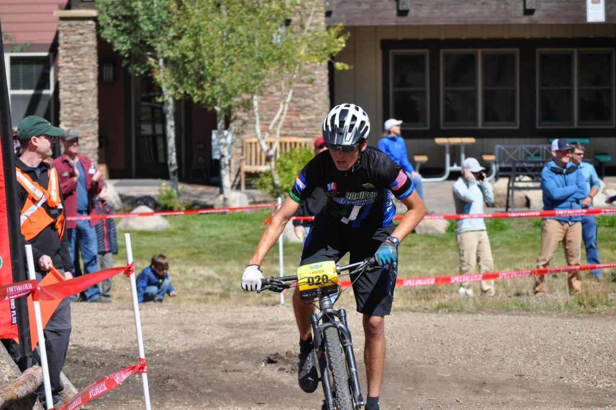 Lander+Turner%2C+varsity+rider+for+the+Conifer+Mountain+Biking+Team%2C+pushes+hard+through+a+turn+in+the+home+stretch+to+finish+his+second+lap.++Turner+finished+12th+at+the+Granby+Ranch+Race.