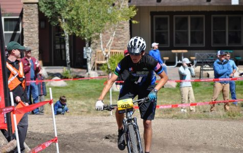 Lander Turner, varsity rider for the Conifer Mountain Biking Team, pushes hard through a turn in the home stretch to finish his second lap.  Turner finished 12th at the Granby Ranch Race.