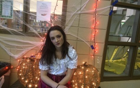 KEY Club president Brenna Nease prepares to head into the haunted house to volunteer, dressed in full vampire get-up. She helped organize and set up the event and greeted attendees on their way into the haunted house.   Photo Courtesy of Parker Jones