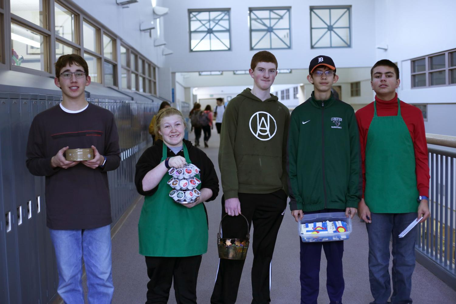 Wyatt Bunch, Maddi Koskinen, Luke Whittington, Joel VanDyne, and Mack Teaff stop for a quick photo between teachers' rooms as they collect coffee orders.  Their