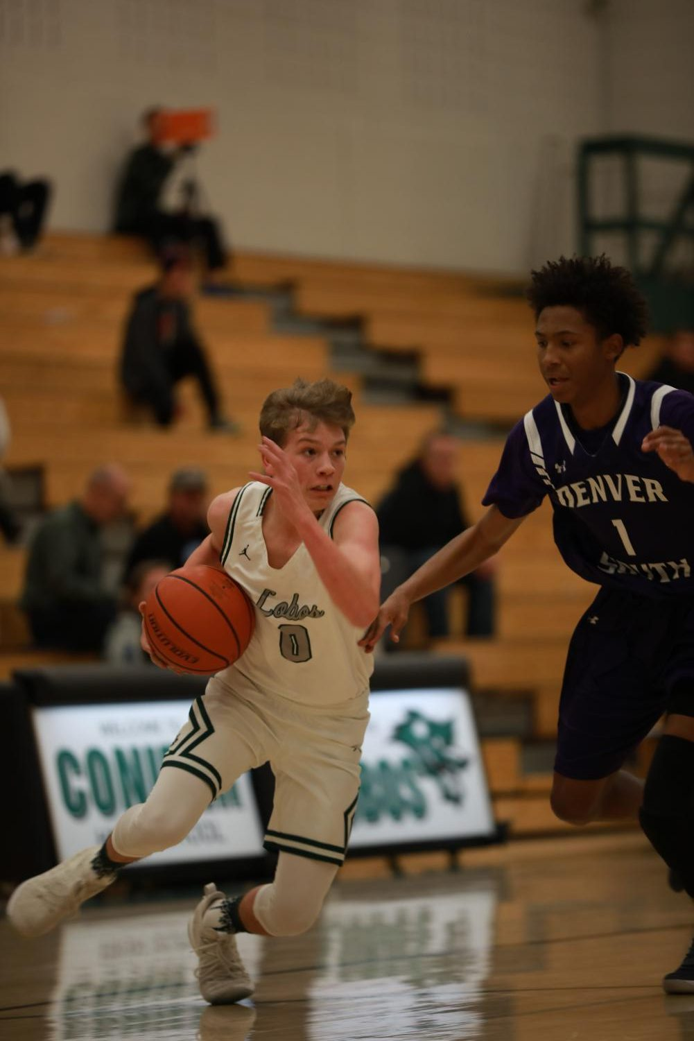 Landon Wallace drives down the court late in the game against Denver South.