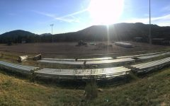 Early morning sunlight illuminates the construction project on the football field.