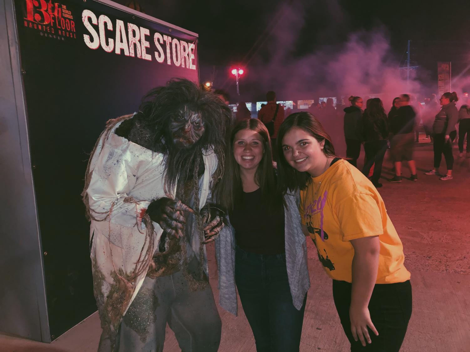 Scary Werewolf takes a quick break to mug for the camera with sophomores Ellie Woodward and Graciela Fischer at Denvers 13th Floor.