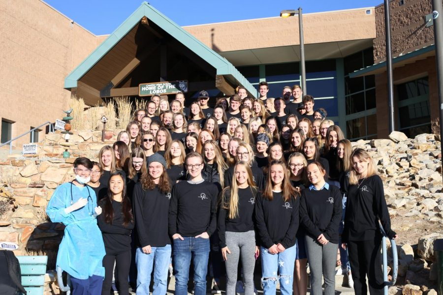 Conifer HOSA proudly poses in front of Conifer High School.