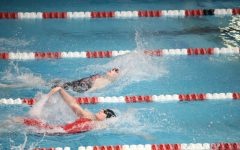 Edging the competition, senior Megan Wilkins heads to a 4th place finish in prelims with a time of 1:01.44.