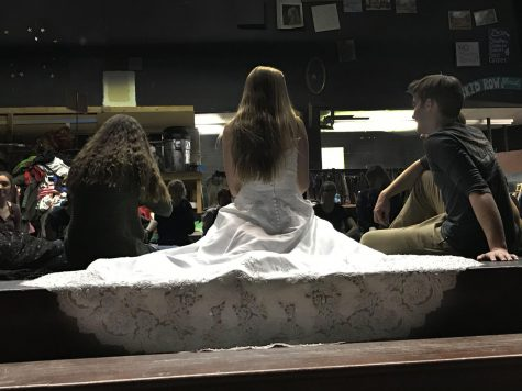 Senior Stella Martin, who plays one of the lead roles, Janet Van De Graff, sits in costume next to her costar, Dylan Roberts.