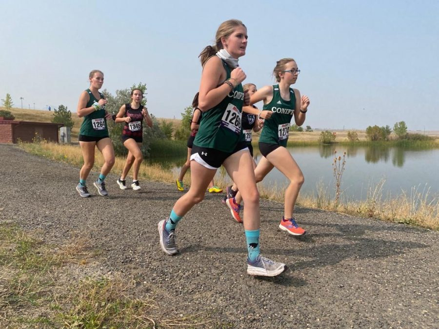 Hanna Banfield, Allison Beston, and Samantha Shaver compete at the Ram Blaster cross country meet