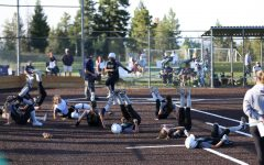 The Lady Lobos show their appreciation for Junior Cheyenne Prieto's game-winning homer at the bottom of the 6th inning during the rivalry game on Monday, September 14. Conifer took the game, 10-0.