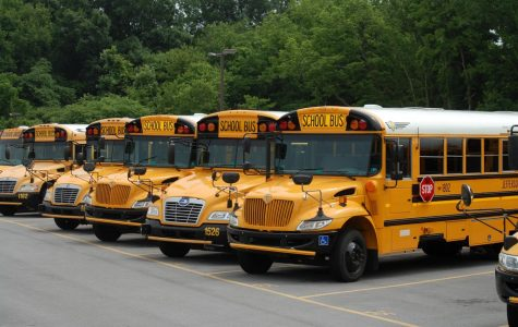 School busses sit idle as the COVID outbreak continues.  Service is expected to resume on October 12.
