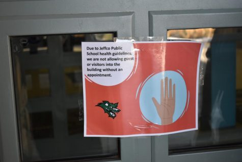 A sign on the door to the commons denying entry to anyone without an appointment