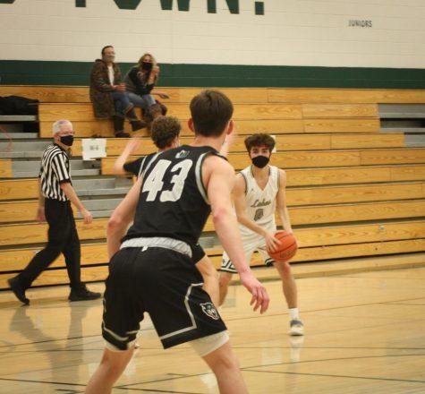 Senior Carson Kennedy takes the ball down the court