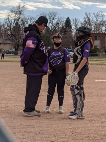 Lauren Thomas, with Coach Dan Mares (left) and teammate Kylie Olson (right)