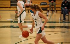 Junior Olivia Sinnett brings the ball down the court
