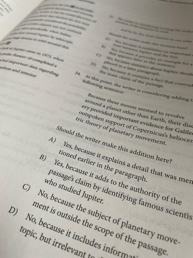 "A page from a SAT study guide book. Some students use study guide books to help prepare them for the SAT. ""The prep book was super helpful,"" Watts said. ""I'm glad I used it because it has a lot of tips and tricks for the harder questions."""