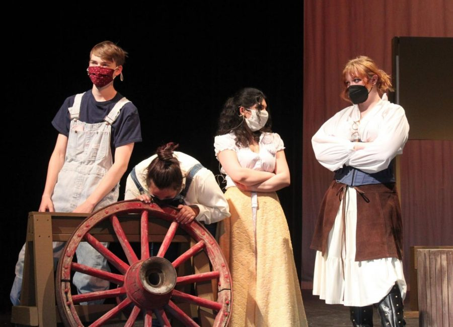"""(Left to right) Bryce Merrill, Angel Montemayor, Shalon Anwar, and Justice Steele prepare for opening night. """"It's been an adventure on and off the stage, working around everything. But we're a family so we are getting through,"""" senior Justice Steele said. The show opens on Friday, in the Conifer High School cafetorium."""