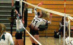 Emily Gnuechtel, sophomore, jousts with Chloe Axelrod, #11, junior, from Golden High School.