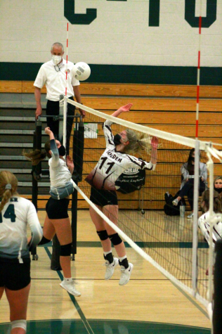 """Emily Gnuechtel, sophomore, jousts with Chloe Axelrod, #11, junior, from Golden High School. """"My favorite part is the team"""
