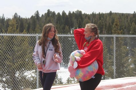 "Olivia McNeill (left) and Shea Hollis walk the track together, talking and enjoying the nice weather. Hollis won her squishmallow playing water pong earlier that day. ""I've been having so much fun, especially winning my squishmallow, but also just hanging out with Olivia,"" Hollis said"