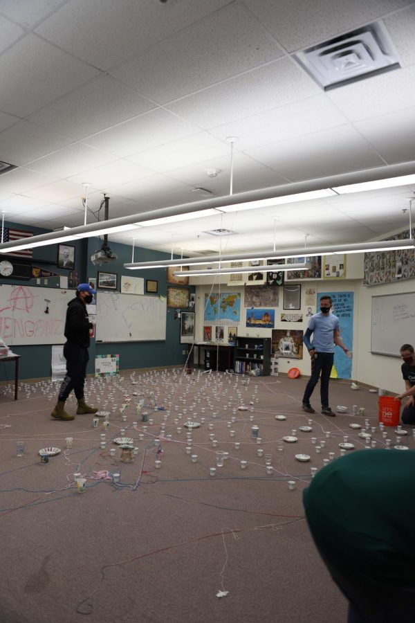 Seniors Luke Shiffers and Aidan Plaehn work on picking up the water-filled dixie cups after pranking Owen Volzke.
