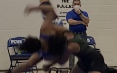 Reagan Schneider (blue singlet) gets a concussion  from a season ending slam
