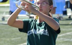 Trumpet player Carley Getz stands at the ready during a football game in September 2019.