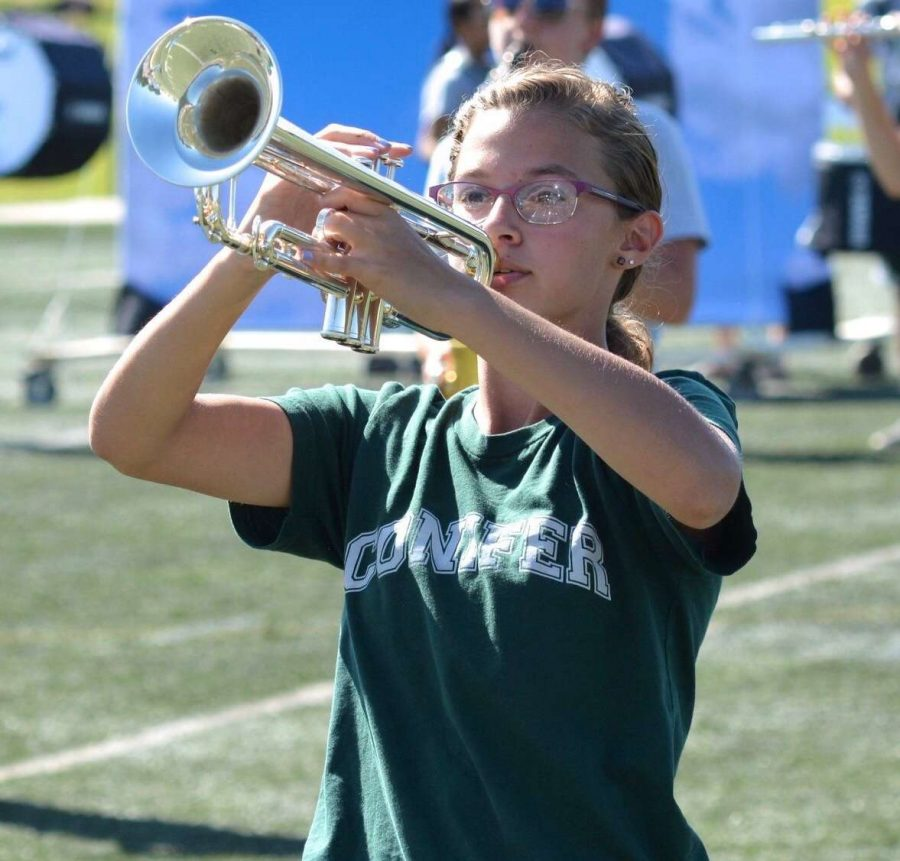 Trumpet+player+Carley+Getz+stands+at+the+ready+during+a+football+game+in+September+2019.