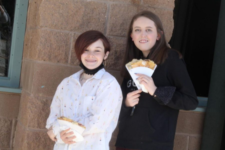 Freshmen Ryli Metcalf and Braidie Bundock show off their crepes during French class.