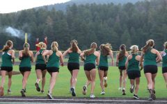 The girls cross country team starts their race against DEvelyn on the Conifer climb.