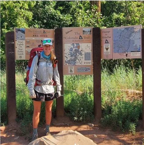 Isabella Namaksy stands before a map of the Colorado Trail after completing her five-week solo hike.