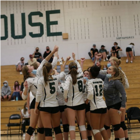 The Lady Lobos chant, preparing themselves for the next match. We put up one heck of a fight, junior Cora Spencer, the teams Libero said.