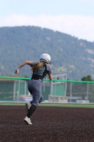 """Senior, Ashley Fritz, makes a run for second base. Fritz has been playing softball for about ten years. """"I just try to think of anything that can help my team score."""" Fritz said."""