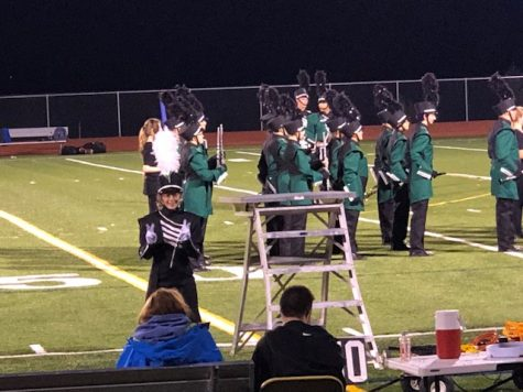 Right before their halftime performance at the football game.