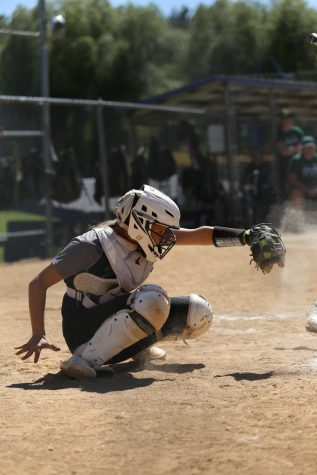 Senior, Megan Fritz, playing as the catcher. Megan Fritz has been playing softball for 11 years. I stay focused by calling pitches, Megan Fritz said. It gives me a say in every play and helps me concentrate on the game.