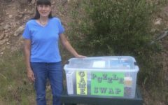 Charlene Pino with her new and updated puzzle tote after replacing the stolen box.