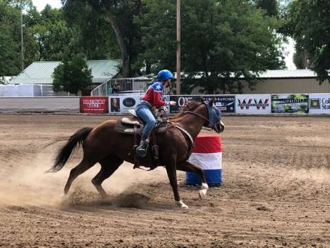 Running in the Colorado State Fair Barrel Race. Ran a time of 18.236 and placed 2nd.