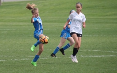 Working hard on the field, Ellie Chase keeps control of the ball.