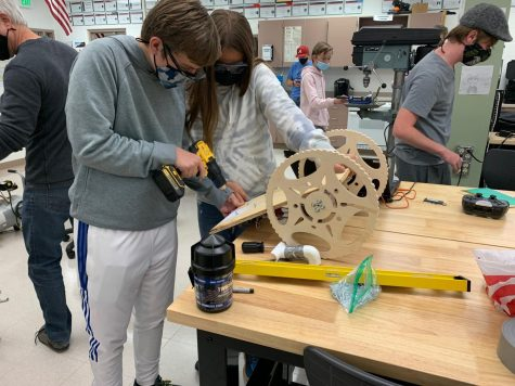 The Blitz team members mount a skid on the prototype