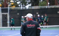 Head coach Ed Doyle walks onto the court during warm-ups at a home game against the Littleton Lions on Oct 4, 2021
