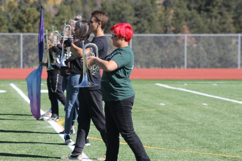 Members of Lobo Regiment are pictured practicing marching, foot timing, and step sizes in preparation for regionals.